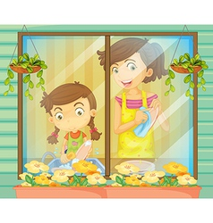A child helping her mother washing the dishes vector image