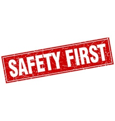 Safety first red square grunge stamp on white vector