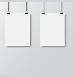 white poster hanging with binder vector image