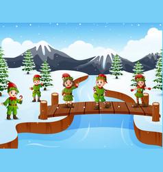 happy kid wearing elf costume on the bridge in the vector image
