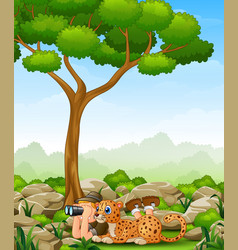 cartoon boy lay down using binoculars with a leopa vector image