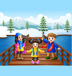 Happy kid on the bridge in the snowing hill vector