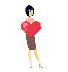 asian business woman holding a big red heart vector image