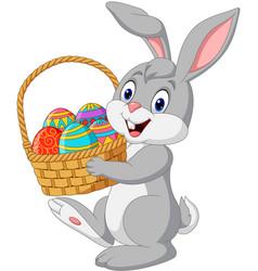 cartoon rabbit holding an easter basket vector image
