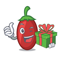 With gift goji berries mascot cartoon vector