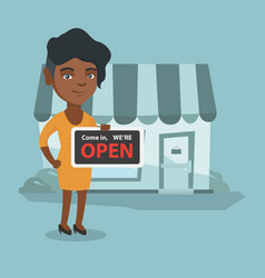 young african shop owner holding open signboard vector image