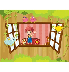 A young boy inside the house waving near the vector