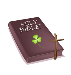 Holy Bible with Wooden Cross and Clover vector image vector image