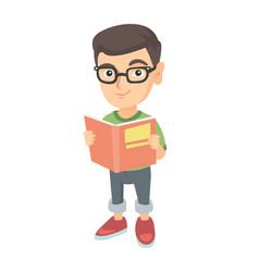 little caucasian schoolboy reading a book vector image