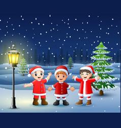 Happy kid wearing santa costume in snowing hil vector