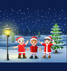 happy kid wearing santa costume in the snowing hil vector image