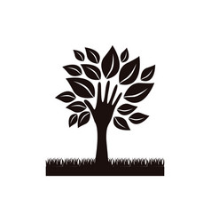 black tree with leaves and grass icon vector image