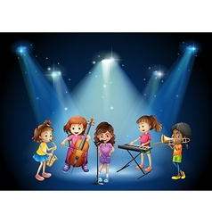 Children playing music in concert vector