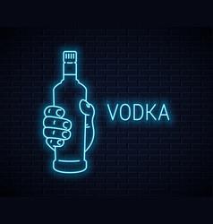 Hand hold vodka bottle neon sign holding a vodka vector