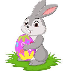 cartoon little rabbit holding easter egg vector image