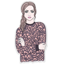 Young girl with animal print jumper vector