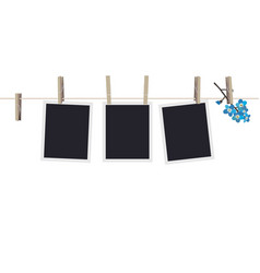 Blank photo frames set hanging on clothespins vector
