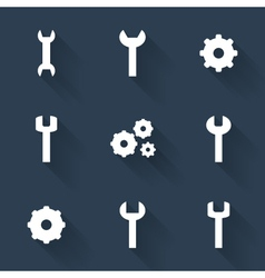 Gear and wrench white icons set over blue vector