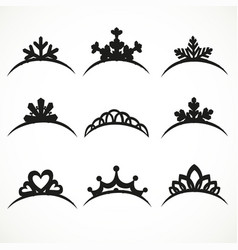 Set silhouettes tiaras various shapes on vector