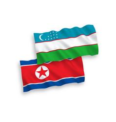 Flags north korea and uzbekistan on a white vector