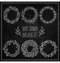 Set of decorative wreaths drawn in chalk on a vector image