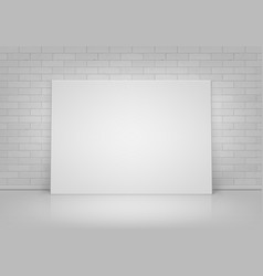 white picture frame standing with brick wall vector image