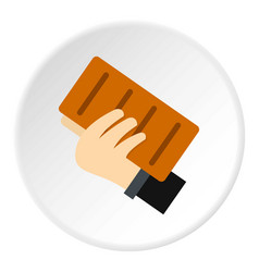 hand holding a brick icon circle vector image