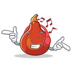 Listening music red kuri squash mascot cartoon vector