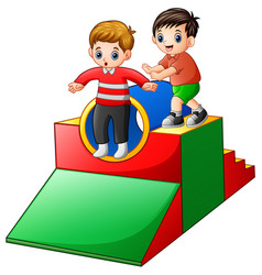 Two boys playing in the playground vector