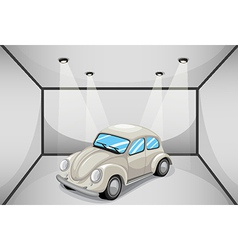 A gray car inside the attached garage vector image