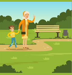happy grandmother spending time with kid in park vector image