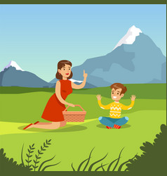 happy mother and son having picnic vector image