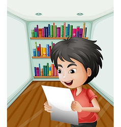 A boy holding a paper inside the room vector