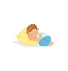 cute little boy sleeping on a pillow cartoon vector image