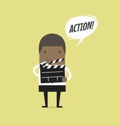 businessman holding movie slate and says action vector image