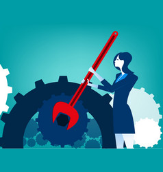 Businesswoman with wrench and cogs vector