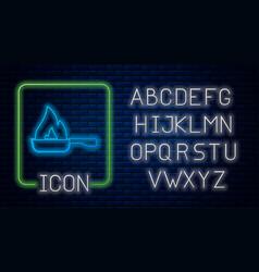 Glowing neon frying pan icon isolated on brick vector