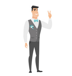 caucasian groom showing the victory gesture vector image