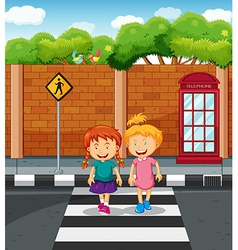 Two girls crossing the road vector