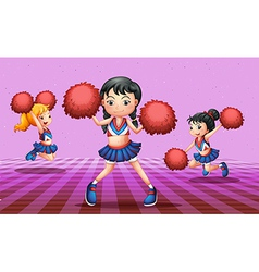 Energetic cheerdancers with red pompoms vector