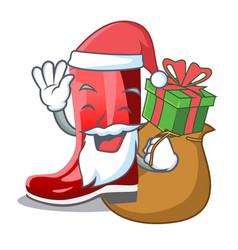 Santa with gift muddy farmer boots shape the vector