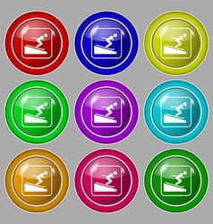 Skier icon sign symbol on nine round colourful vector image