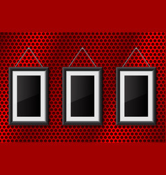 Three black empty pictures on red metal perforated vector