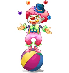 A clown juggling above the ball vector image vector image