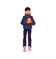 Handsome young man making a snowball vector image vector image
