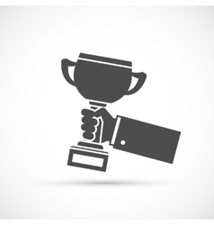 Holding trophy cup in hand vector image