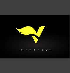 Letter v logo with yellow colors and wing design vector