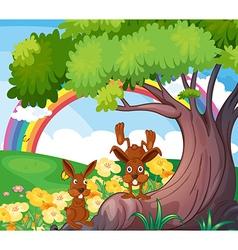 Playful wild animals under big tree vector