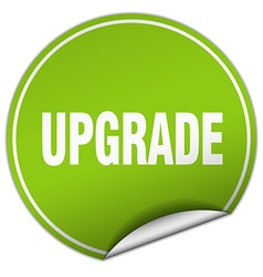 Upgrade round green sticker isolated on white vector