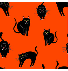 Halloween pattern with black cats on orange vector
